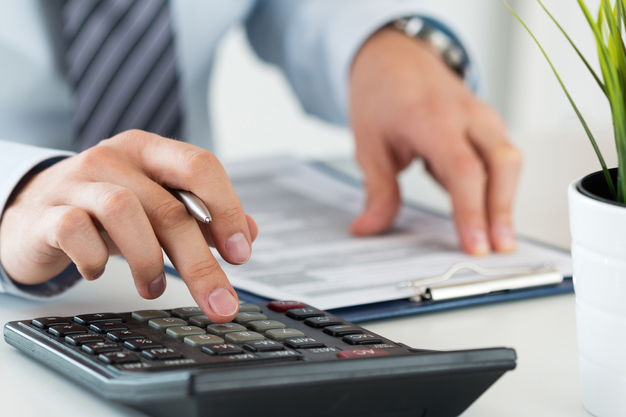 CPA using a calculator to complete a form