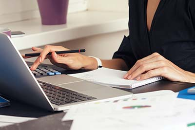 business woman in accounting role image