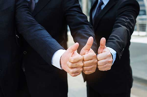 image of 3 business men giving a thumbs up